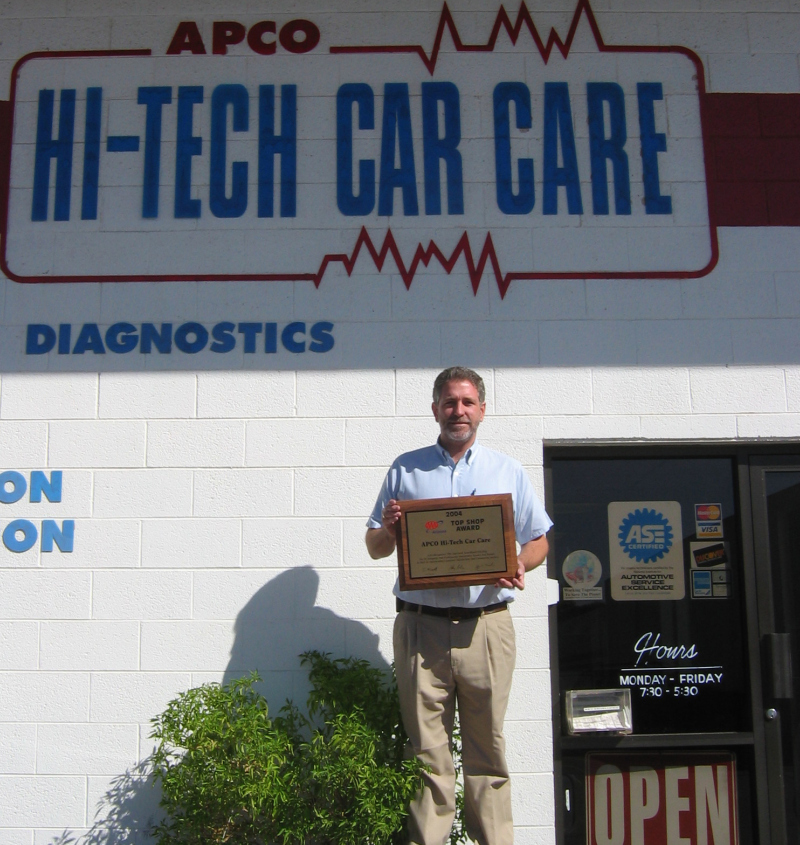 800pix-hi-Tech-Jim-Holding-AAA-Sign